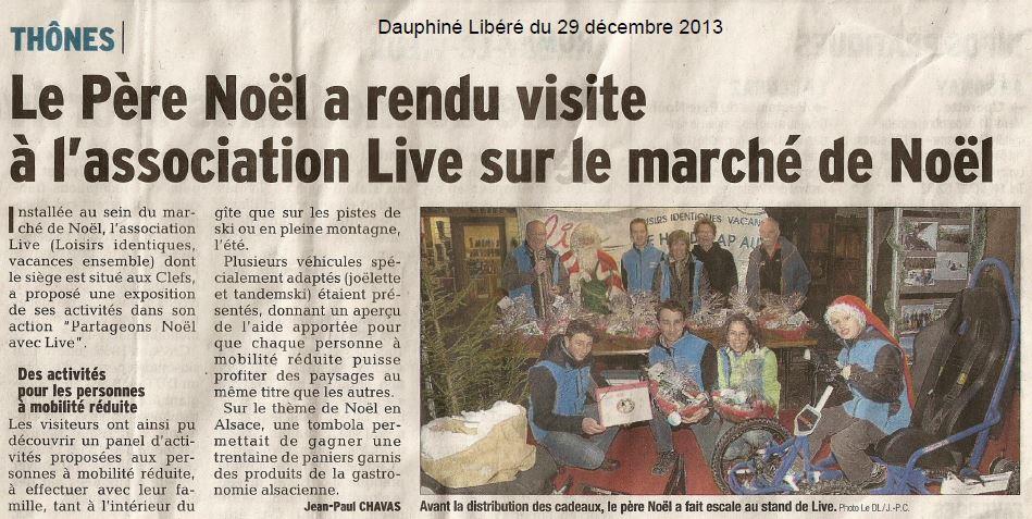 Article du Dauphiné Libéré LIVE au marché de Noël de Thônes avec le père noël